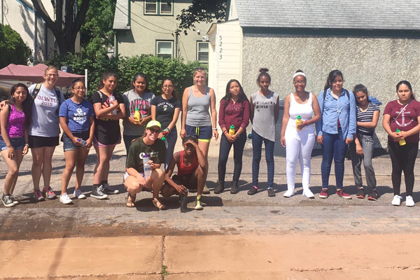 Students from Folwell Middle School helped to plant the Blooming Alleys around Diamond Lake
